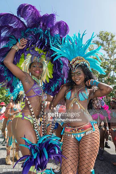 Two local Bajan girls wearing colourful costumes during the Crop Over festival in Bridgetown Barbados 5th August 2013