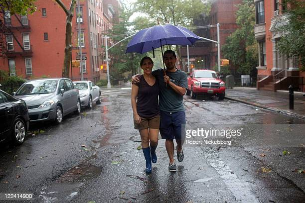Two local residents walk along Hicks Street in Brooklyn Heights August 28 2011 in the Brooklyn borough of New York City While Hurricane Irene has now...