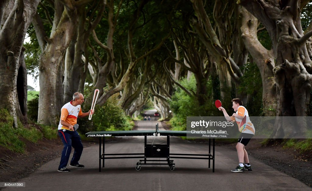 Two local table tennis players play a game on the stretch of road known as the Dark Hedges as the Queen's Baton Relay makes a short stop on it's journey on August 29, 2017 in Antrim, Northern Ireland. The Dark Hedges near Stranocum in County Antrim featured as the King's Road in season two of Game of Thrones and has become a tourist mecca for fans of the television series along with other filming locations in the province. The Queen's Baton Relay is currently on a tour of the United Kingdom as it makes its way around Europe in preparation for the 2018 Commonwealth Games in Australia.