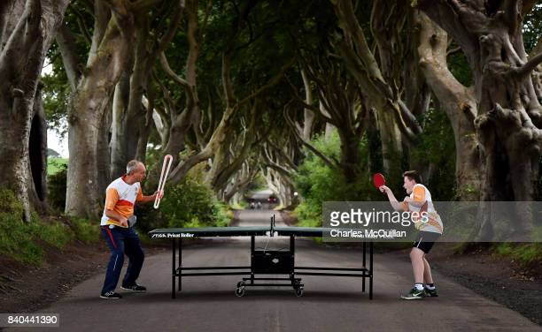 Two local table tennis players play a game on the stretch of road known as the Dark Hedges as the Queen's Baton Relay makes a short stop on it's...