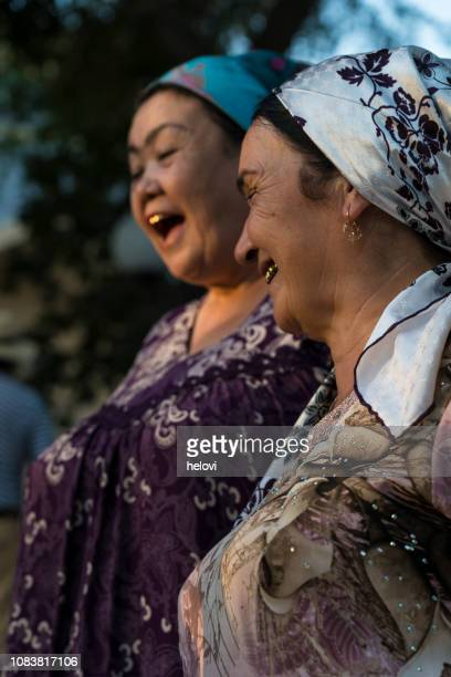 two local woman in bukhara, uzbekistan - gold tooth stock photos and pictures