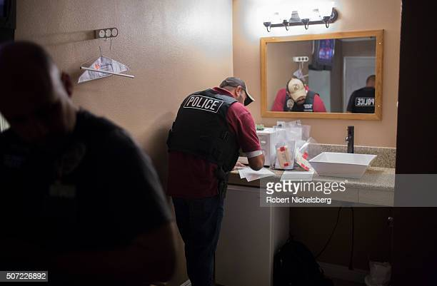 Two Los Angeles police officers both from the Human Trafficking Task Force fill out paperwork in a motel room following an arrest Los Angeles...