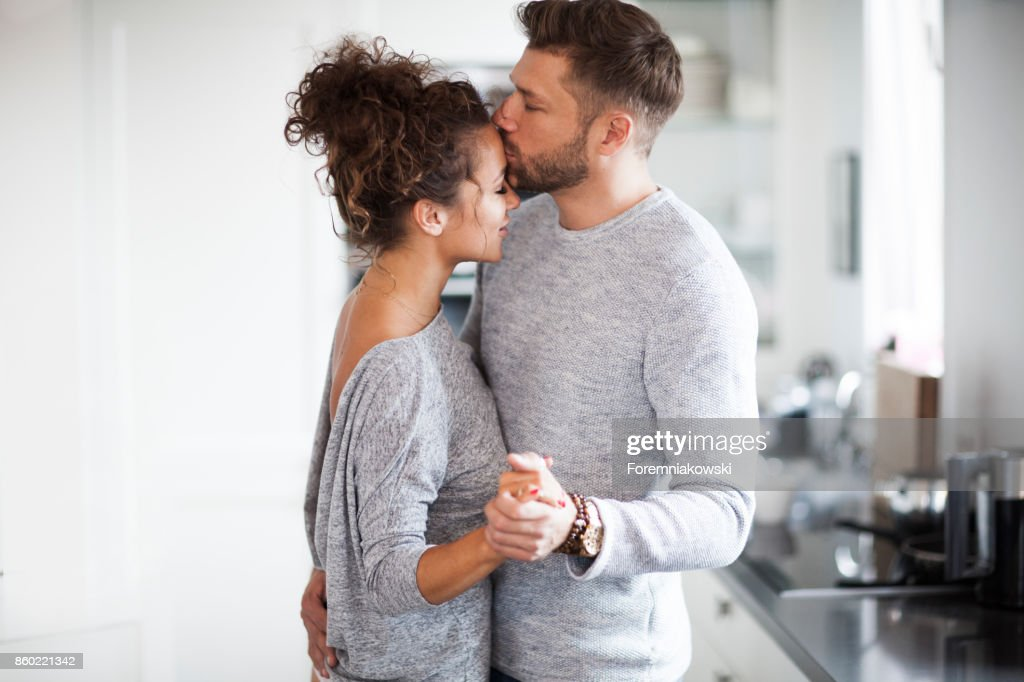 Two Lovers dancing in the kitchen. : Stock Photo