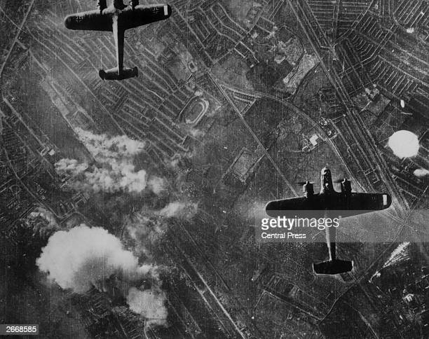 Two Luftwaffe Dornier 217 twin engined medium bombers flying over the Silvertown area of London's Docklands on 7th September 1940 at the beginning of...