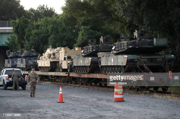 Two M1A1 Abrams tanks and other military vehicles sit on guarded rail cars at a rail yard on July 2 2019 in Washington DC President Trump asked the...