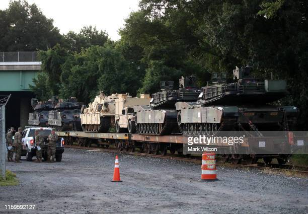 Two M1A1 Abrams tanks and other military vehicles sit on guarded rail cars at a railyard on July 2 2019 in Washington DC President Trump asked the...