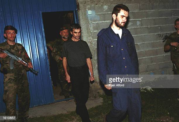 Two Macedonian prisoners leave their National Liberation Army captors and are handed over to the International Committee for the Red Cross on August...