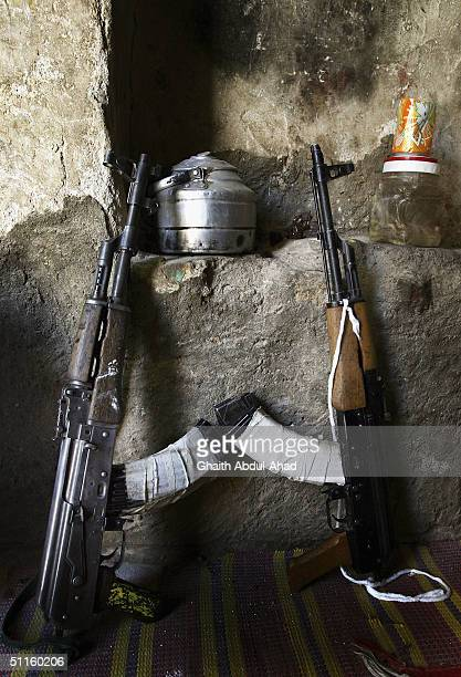 Two Mahdi army guns are seen resting against the wall in a cellar used by the militia as a shelter during more fighting on August 11 2004 in the holy...