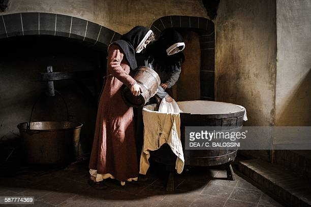 Two maids washing clothes in a tub Italy Northern 15th century Historical reenactment