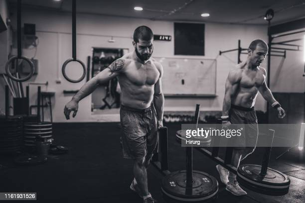 two male athlete training - circuit training stock photos and pictures