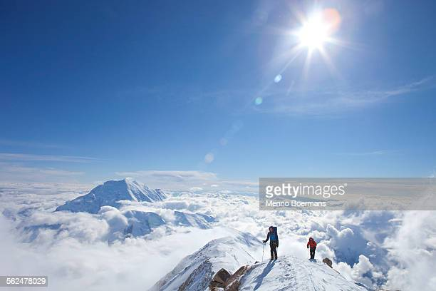 two male climbers at the ridge between 14k and 17k camp on mount mckinley, alaska. - snowcapped mountain stock pictures, royalty-free photos & images