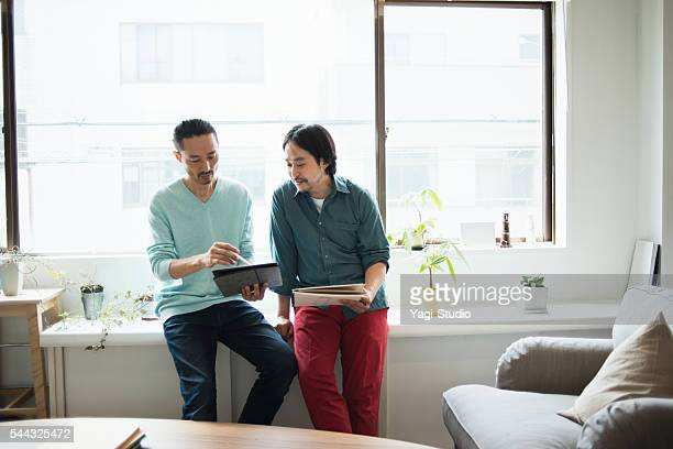 Two male designers working in studio