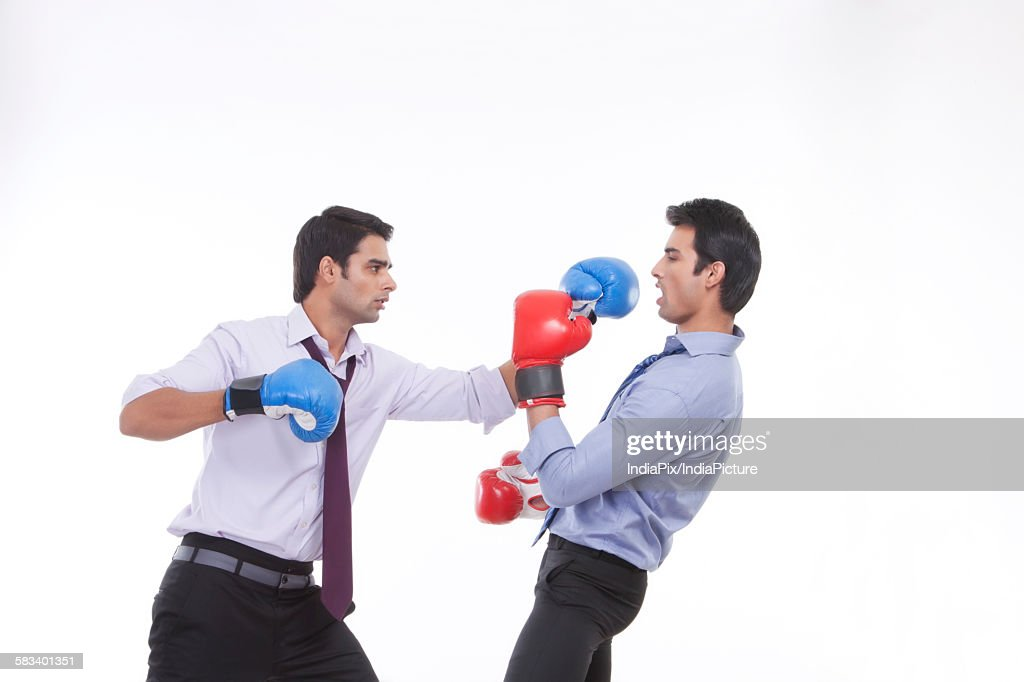 Two male executives boxing : Stock Photo