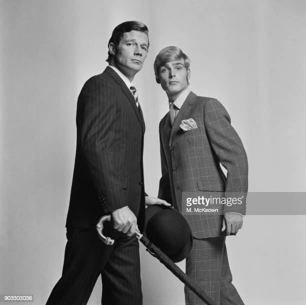 Two male fashion models wearing pinstripe suit and bold check suit UK 9th October 1968