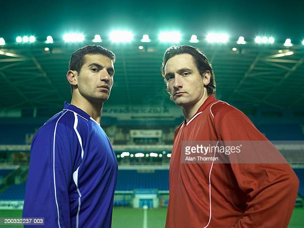 two male football players on pitch, portrait, night - challenge stock pictures, royalty-free photos & images