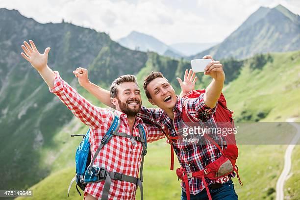two male friends photographing themselves, tyrol, austria - checked shirt stock photos and pictures