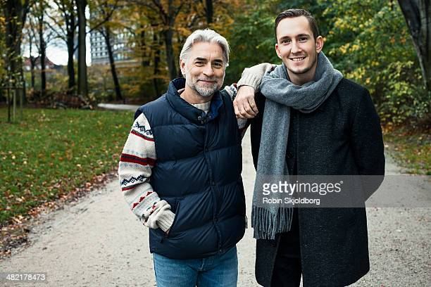 two male friends posing in woods - robin skjoldborg stock pictures, royalty-free photos & images