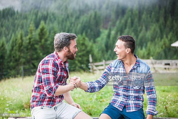 Two male friends shaking hands, Tyrol Austria