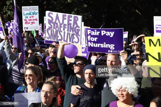 June 9: Two male healthcare workers take part in a rally at Parliament in Wellington, New Zealand on June 09, 2021. About 30,000 members of the New...