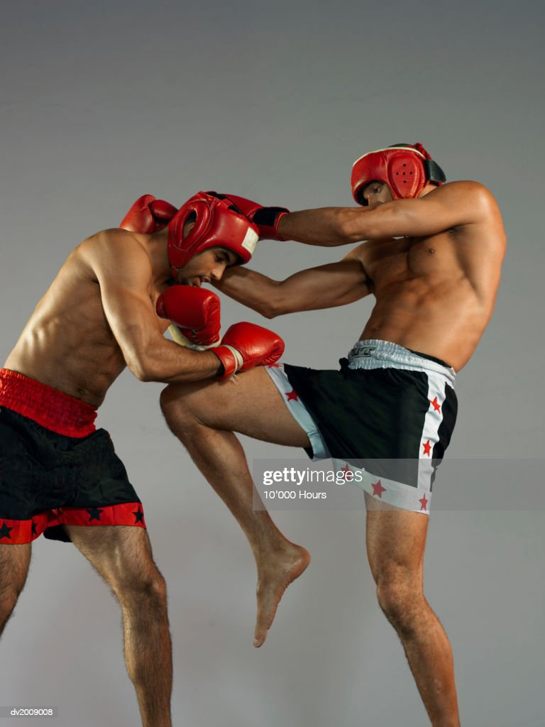 Two Male Kick Boxers in a Fight : Stock Photo