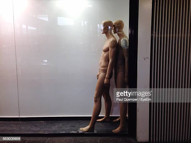 Two Male Mannequins At Window Display