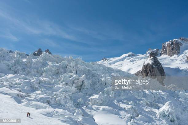Two male skiers looking at the Vallée Blanche glacier in Chamonix France on 20th March 2017