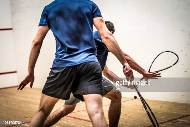 two male squash players during a game - racquet stock pictures, royalty-free photos & images