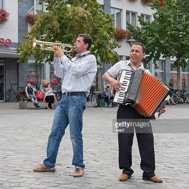 two male street musicians making music on market square, germany - accordion stock pictures, royalty-free photos & images