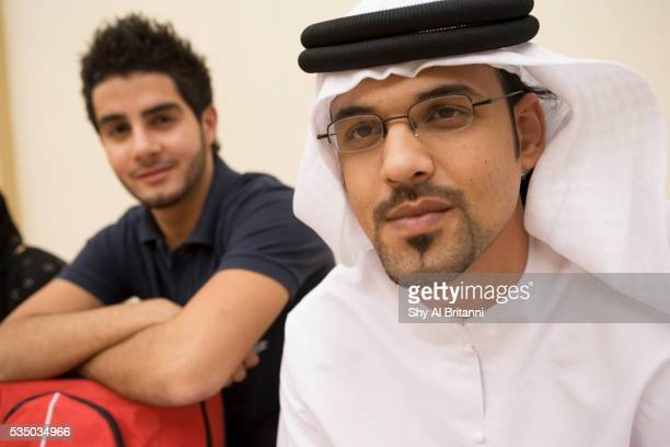 two male students enjoying their break time - gulf countries stock pictures, royalty-free photos & images