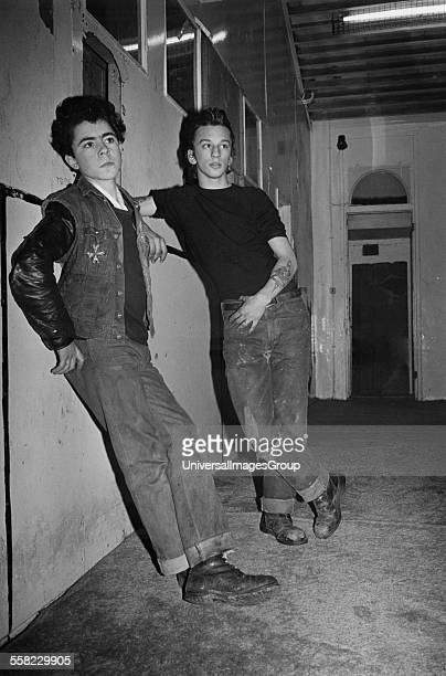 Two male teenagers leaning against a wall Addison Boys' Club Fulham London 1977