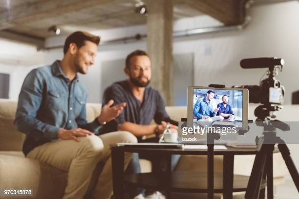 two male video blogger - behind the scenes stock pictures, royalty-free photos & images