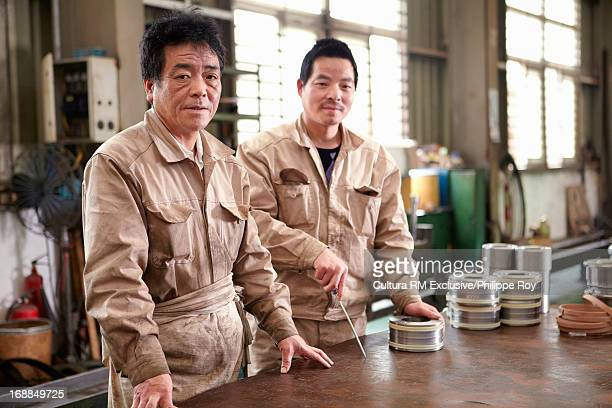 Two male workers in hydraulics factory