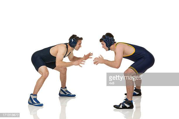 two male wrestler in action - wrestling stock pictures, royalty-free photos & images