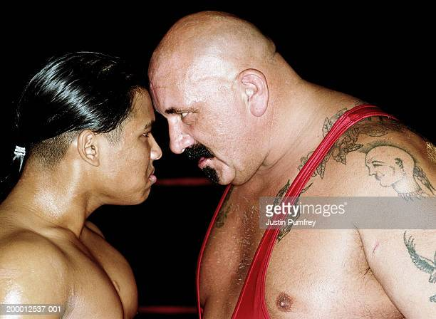 Two male wrestlers head to head, close-up