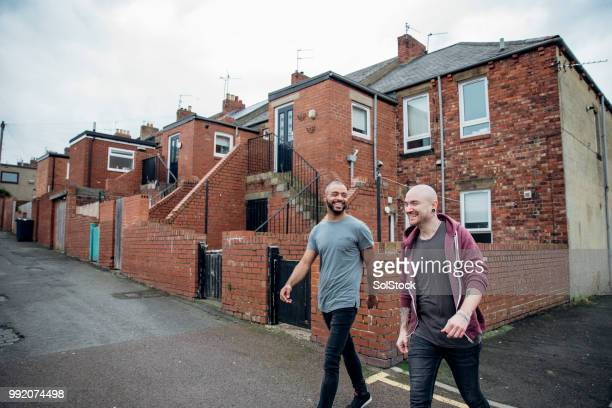 two males walking down the street - skinhead stock pictures, royalty-free photos & images