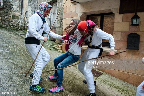Two Mamuxarros simulate the kidnapping of a young girl during the carnival Unanua in Navarra UNANUANAVARRASPAIN In the carnival of Unanua the most...