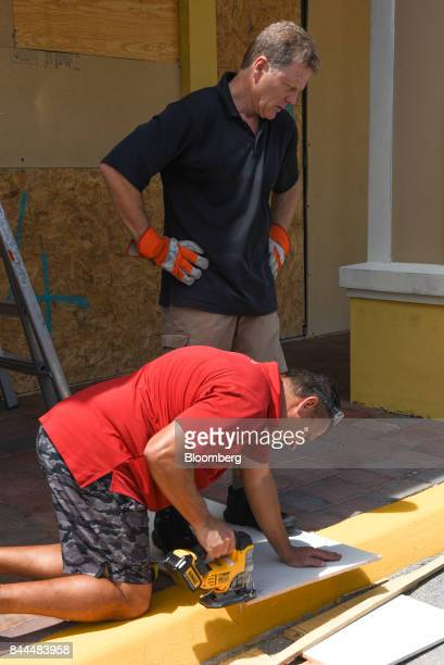Two man board up a property ahead of Hurricane Irma in Boca Raton Florida US on Friday Sept 8 2017 Hurricane Irma bulked up ahead of an all but...