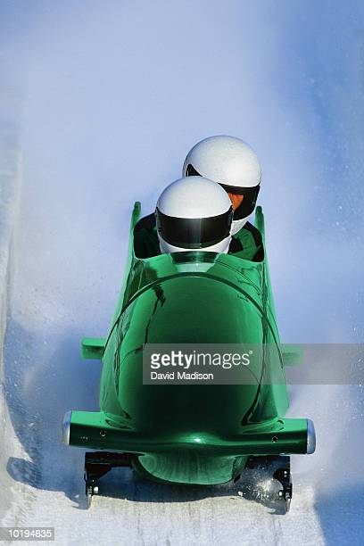 two man bob sled on track, view from front (digital enhancement) - ボブスレーをする ストックフォトと画像