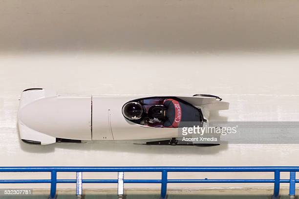 Two man bobsled on track, overhead view