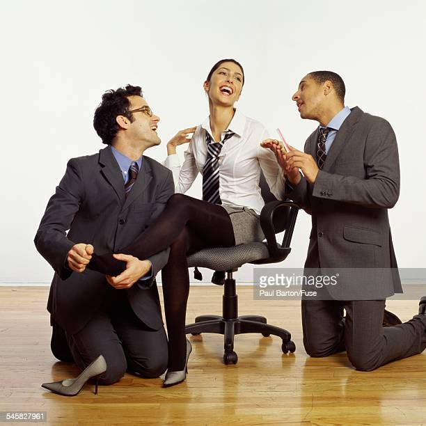 two man spoiling woman - women dominating men stock photos and pictures