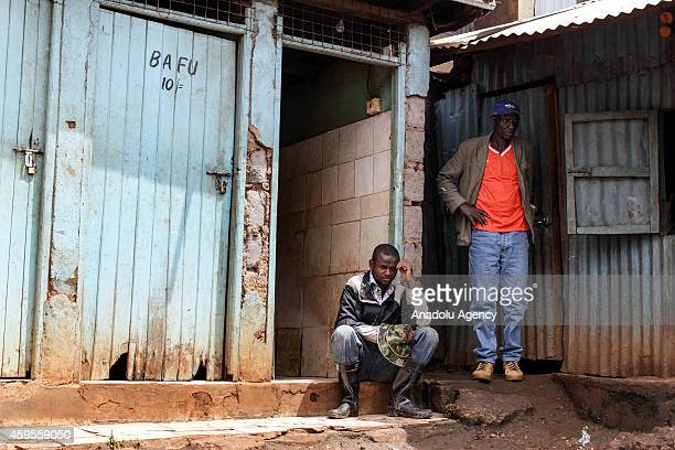 Two man wait for toilet in Kibera Nairobi Kenya on November 20 2014 They pay money for toilette and they live difficult conditions due to lack of...