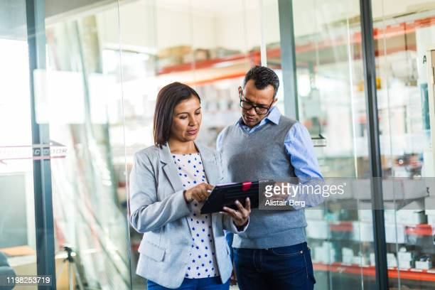 two managers talking in a small business - small business stock pictures, royalty-free photos & images