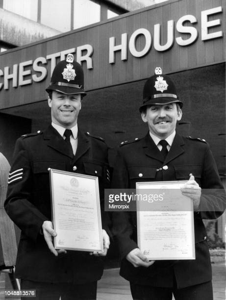 Two Manchester policemen stoned by rioting pickets as they fought to save a miner's life have earned a top award Dramatic pictures of Sgt George...