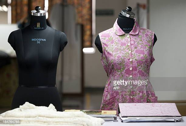 Two mannequins are used to test dress fittings at the April Cornell clothing factory in Noida on the outskirts of New Delhi on October 16 2012 The...