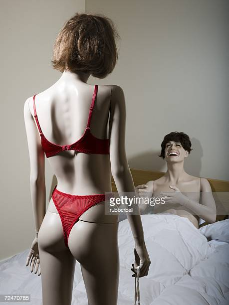 Two mannequins portraying a heterosexual couple in the bedroom