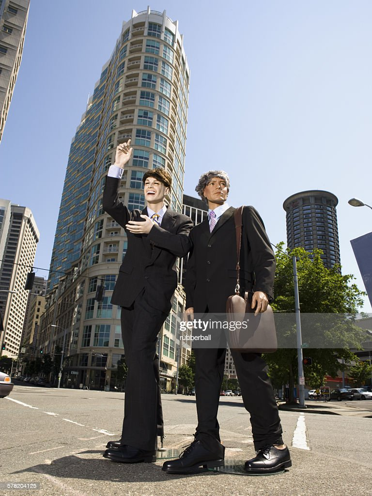 Two mannequins portraying businessmen : Stock Photo