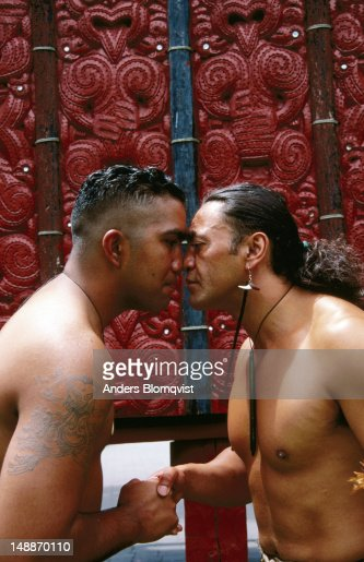 Two maori men doing hongi traditional nose to nose greeting at te two maori men doing hongi traditional nose to nose greeting at te whakarewarewa stock photo getty images m4hsunfo