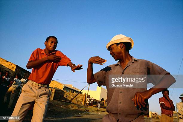 Two mapantsula dancers similar to break dancing perform in a street in Soweto South Africa