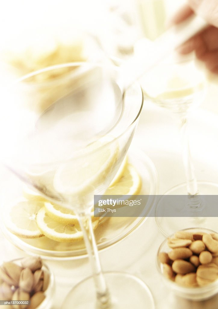 Two martini glasses,  nuts and slices of lemon. : Stockfoto