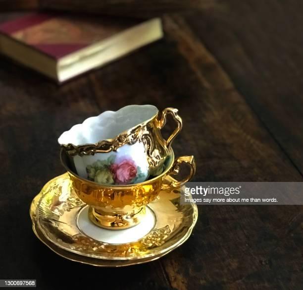 two marvelous tea cups over a wooden table. still life. - britisches königshaus stock-fotos und bilder